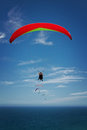 Para glider over ocean a against a blue sky and the open oean Royalty Free Stock Photo