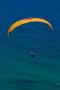 Para glider over ocean a against a blue sky and the open oean Stock Image