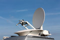 Parabolic antenna satellite communications dish of mobile device communication with a metallic reflex reflector in operation Stock Photo