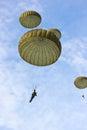 Parachute in the blue sky Stock Photos