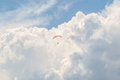 Parachute in the clouds in the middle of the day Royalty Free Stock Photo