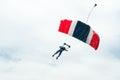 Parachute descending under the clouds Stock Images