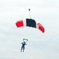 Parachute descending under the clouds Royalty Free Stock Images