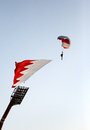 Parachute display team performs before cricket festival at Isa Town, Bahr Royalty Free Stock Photo