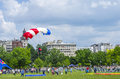 Parachute jumper in the city flight on cloudy background at red bull ordinul smaranda competition on june bucharest romanianthe Stock Image