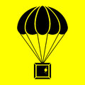 Parachute with the parcel on a yellow background Royalty Free Stock Images