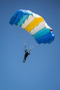 Parachutist on the blue sky Stock Photo