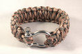Paracord braclet a length of parachut cord wound into a stylish held in place with a stainless steel u link Stock Image