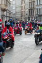 The parade of santa clauses on motorcycles around the main market square in cracow poland december Royalty Free Stock Photography