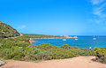 The paradise coastline best way to get beach of cala spalmatore from sardinia is yacht or small ship la maddalena italy Stock Image