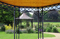 Paradise garden pergolas photo of park scene taken from under a summer pergola Stock Photography