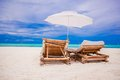Paradise view of nice tropical empty sandy plage with umbrella and beach chair see my other works in portfolio Stock Photography