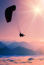 Paraglide flying silhouette over misty mountain valley Royalty Free Stock Image