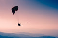 Paraglide silhouette over mountain peaks Stock Photography