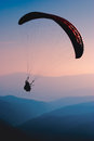 Paraglide silhouette over mountain peaks Royalty Free Stock Photography