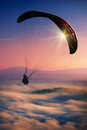 Paraglide in a sky silhouette over misty mountain valley Royalty Free Stock Photo