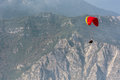 Paraglider above the lake garda in italy Royalty Free Stock Photo