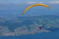 Paraglider above a lake pilot circles the of zurich Stock Images
