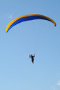 Paraglider in the blue sky a soars against a south downs sussex Stock Photography