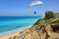 Paraglider flying above sea israel Stock Photos