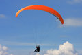 Paraglider flying in a blue sky Royalty Free Stock Photo