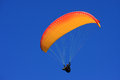 Paraglider flying in a blue sky Stock Images