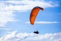 Paraglider flying on blue sky red Royalty Free Stock Photo
