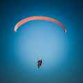 Paraglider flying over the beach with a paramotor Stock Image
