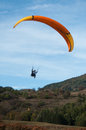 Paraglider  going to land in a field Royalty Free Stock Photo