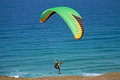 Paraglider launching from a cliff top Royalty Free Stock Image