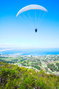 Paraglider launching from the ridge with a yellow and white canopy the shot is taken right after takeoff the canopy wingtip is Stock Image