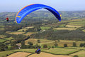 Paraglider over dartmoor paragliders flying fields Royalty Free Stock Photo