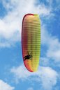 Paraglider over head on the background of blue sky with clouds Stock Photos
