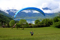 Paraglider over lake annecy launching by Royalty Free Stock Photography