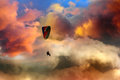 Paraglider over magic sky flying into colorful clouds Royalty Free Stock Photography