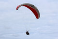 Paraglider red flying in australia Royalty Free Stock Image