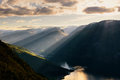 Paraglider silhouette flying over Aurlandfjord, Norway Royalty Free Stock Photo