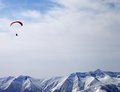 Paraglider silhouette of mountains in sunlight sky caucasus georgia ski resort gudauri Stock Photography