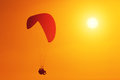 Paraglider silhouette of soaring at sunset Royalty Free Stock Photography