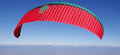 Paraglider in the sky red sunny day Royalty Free Stock Photography