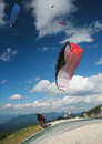 Paraglider taking off in the alps from top of tegelberg mountain schwangau bavaria Stock Photo