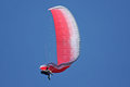 Paraglider with a wing collapse flying Stock Images