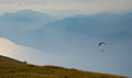 Paragliders flying over the sky of italy Royalty Free Stock Image