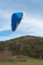 Paragliders  going to land in a field Royalty Free Stock Photo
