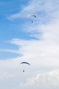 Paragliders two flying through clouds Stock Photography