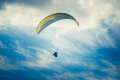 Paragliding extreme sport with blue sky and clouds on background healthy lifestyle freedom concept summer vacations Royalty Free Stock Images