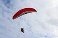 Paragliding red paraglider flying in australia Royalty Free Stock Photo