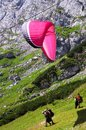 Paragliding tandem take off from a mountain is a recreational and competitive adventure sport of flying paragliders Stock Images
