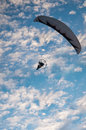Paragliding vertical photo of motor powered against blue sky Stock Photos