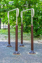 Parallel bars for sports in summer green park Stock Image